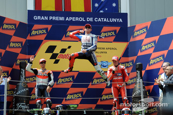 Podium: race winner Jorge Lorenzo, Fiat Yamaha Team, second place Dani Pedrosa, Repsol Honda Team, third place Casey Stoner, Ducati Marlboro Team