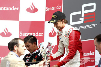 Esteban Gutierrez celebrates victory on the podium with Rio Haryanto