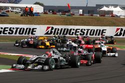 Michael Schumacher, Mercedes GP leads Jenson Button, McLaren Mercedes