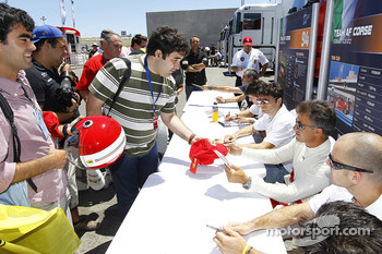 Autograph session: Giancarlo Fisichella and Jean Alesi