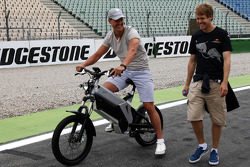 Michael Schumacher, Mercedes GP takes a look at the track and chats with Sebastian Vettel, Red Bull Racing as he walks the track