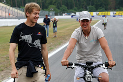 Sebastian Vettel, Red Bull Racing walks the track and has a chat with Michael Schumacher, Mercedes GP