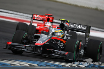 Bruno Senna, Hispania Racing F1 Team leads Timo Glock, Virgin Racing