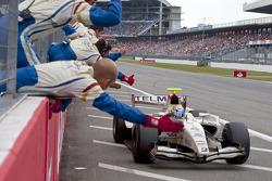 Sergio Perez crosses the line to take victory
