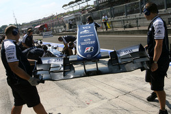 Williams F1 Team mechanics with the front wing