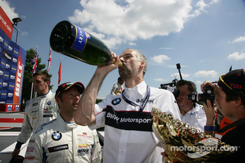 Jan Hartmann Head of Touring and Entourance Cars at BMW with Champagne