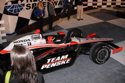 Race winner Helio Castroneves, Team Penske enters victory lane