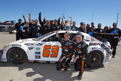 2010 Grand Am Rolex Series champions in GT class Emil Assentato and Jeff Segal celebrate with SpeedSource team members