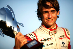 Esteban Gutierrez celebrates victory in the race and the championship