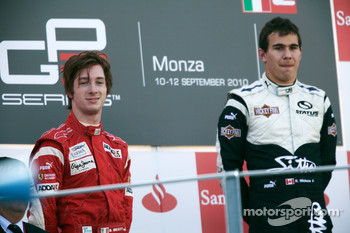 Robert Wickens celebrates victory on the podium with Mirko Bortolotti