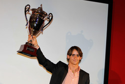 Esteban Gutierrez receives the prize for 1st overall in the Championship