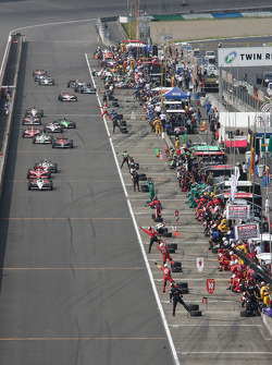 Helio Castroneves, Team Penske leads the field on pitlane