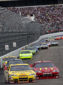 Clint Bowyer, Richard Childress Racing Chevrolet leads Jamie McMurray, Earnhardt Ganassi Racing Chevrolet