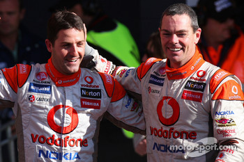 Craig Lowndes and Jamie Whincup celebrate as TeamVodafone take home first and second in the 2010 Bathurst 1000