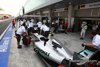 The Mercedes team pull the cars into the pit lane to tighten their wheel nuts