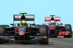 Bruno Senna, Hispania Racing F1 Team leads Jenson Button, McLaren Mercedes