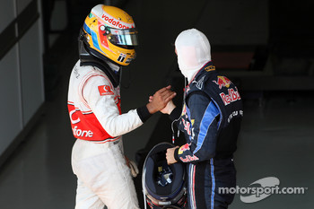 Race winner Sebastian Vettel, Red Bull Racing celebrates with Lewis Hamilton, McLaren Mercedes
