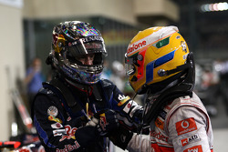 Race winner and 2010 Formula One World Champion Sebastian Vettel, Red Bull Racing, celebrates with Lewis Hamilton, McLaren Mercedes