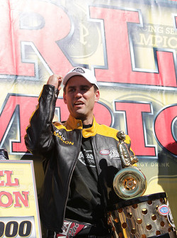 Larry Dixon celebrates after winning his 5th Top Fuel Championship