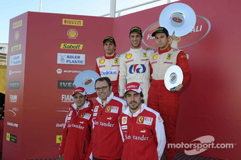 Felipe Massa, Stefano Domenicali and Fernando Alonso on a podium
