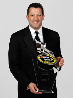 NASCAR driver Tony Stewart poses with his seventh place trophy