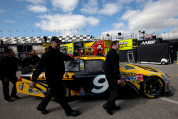 Car of Marcos Ambrose, Petty Motorsport Ford pushed to technical inspection