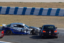 #40 Berg Racing Mazda RX-8: Robert Mitten, John Weisberg sits in the middle of the track in front of #4 Doran Racing BMW 128i: Joe Masessa, Bret Sandberg, Ari Straus