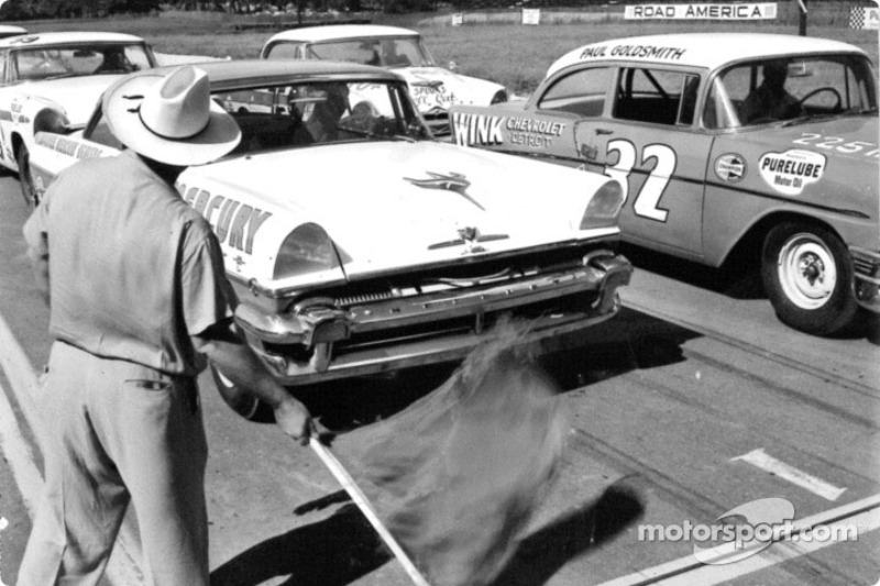 The green flag waves for the first NASCAR race run at Road America: Tim Flock won the race