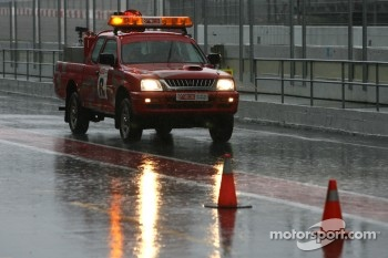 Heavy rain hits circuit de Catalunya for the last day of testing, security car in the pitlane