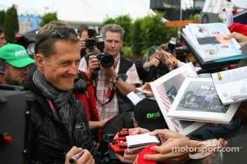 Michael Schumacher, Mercedes GP Petronas F1 Team signs an autograph