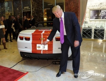 Donald Trump checks out his new ride as the 2011 Indianapolis 500 Chevrolet Camaro SS Convertible Pace Car driver for the 100th Anniversary of the Indianapolis 500