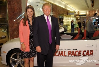 Donald Trump checks out his new ride as the 2011 Indianapolis 500 Chevrolet Camaro SS Convertible Pace Car driver for the 100th Anniversary of the Indianapolis 500 with ESPN reporter Jamie Little