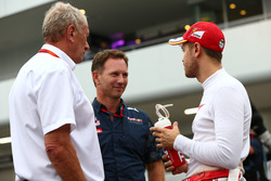 (L to R): Dr Helmut Marko, Red Bull Motorsport Consultant with Christian Horner, Red Bull Racing Team Principal and Sebastian Vettel, Ferrari