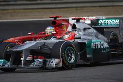 Fernando Alonso, Scuderia Ferrari and Michael Schumacher, Mercedes GP
