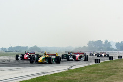 Alex Tagliani leads a group of cars