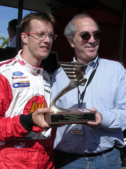 Sébastien Bourdais receives his trophy as an All American first team member from Lewis Franck of the American Auto Racing Writers and Broadcaster Association