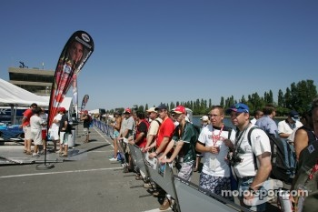 Fans watch paddock activity
