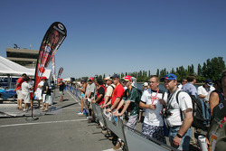 Fans watch paddock activity