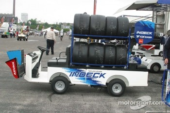Golf carts carry spare parts since the pit lane is a great distance from the pits