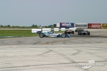 Paul Tracy sits in the middle of corner 1