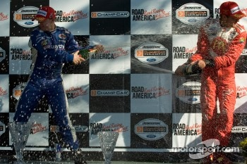 Podium: champagne for A.J. Allmendinger and Sbastien Bourdais