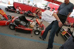 Allan McNish checks out the go-karts