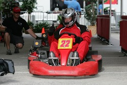 Roger Clemens starts his run in a go-kart