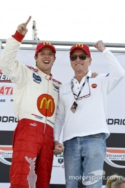 Sebastien Bourdais celebrating his last open-wheel win with the legendary Paul Newman