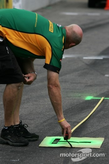 Team Australia crew member prepares pitlane