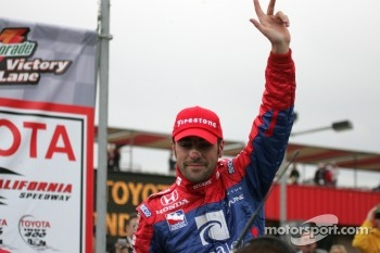 Race winner Dario Franchitti celebrates