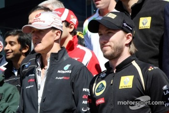 Michael Schumacher, Mercedes GP F1 Team, Nick Heidfeld, Lotus Renault GP