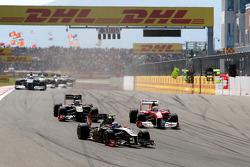 Vitaly Petrov, Lotus Renault GP, R31 leads Felipe Massa, Scuderia Ferrari, F150