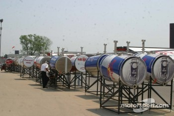 IRL inspectors work on the fuel supply resevoirs for race day