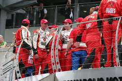 Dan Wheldon's crew celebrate above victory lane